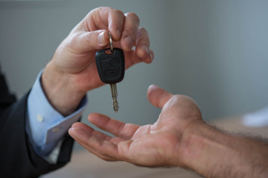 Man handing over a car key