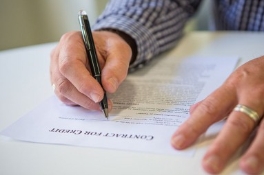 person signing contract for credit